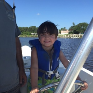 Jeremiah driving our boat.