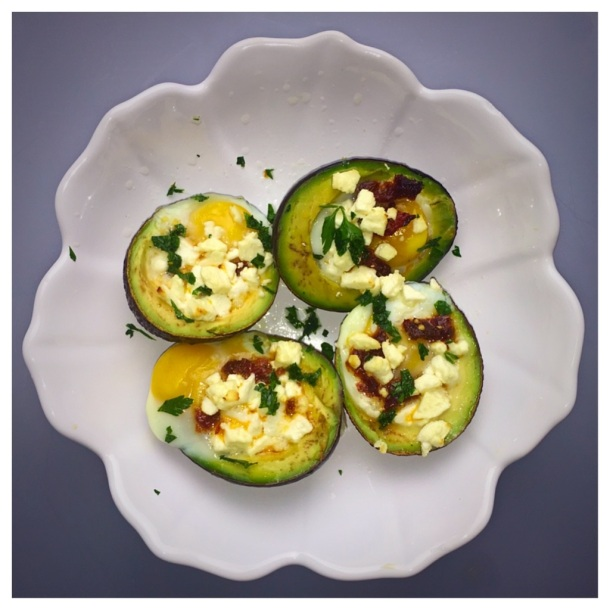 Baked Avocado with Egg, Sun-dried tomato and feta cheese
